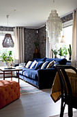Dark blue sofa and vintage-style wallpaper in living room