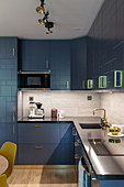Modern, fitted kitchen with blue, structured cabinets