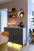 Sideboard with under-cabinet lighting in dining room