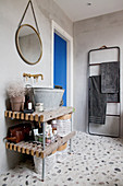 Sink made from rustic zinc tub on open wooden shelves in bathroom