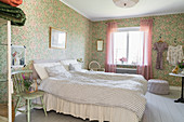 Granny-chic bedroom with romantic floral wallpaper