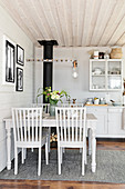 Dining table in rustic kitchen-dining room in shades of grey