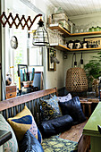 Cushions on bench in rustic, vintage-style kitchen