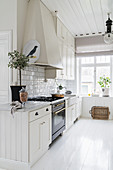 Bright kitchen with white wooden floor