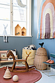 Rocking horse and vintage accessories in nursery in muted shades