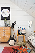 Teenager's attic bedroom with sloping ceiling and wood panelling