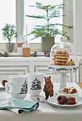 Mugs painted with fir trees on set table