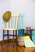 Wooden chairs painted in pastel colours