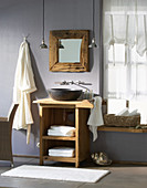 Rustic bathroom with stone sink on wooden table