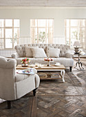 Cream Chesterfield furniture in elegant living room