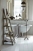Ladder-style shelves and free-standing bathtub in romantic bathtub