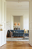 Blue Chesterfield sofa in period interior with panelled doors