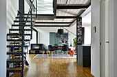 Staircase leading to gallery on steel joists in modern loft apartment