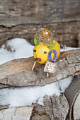 Lucky pig made from lemon as whimsical wintry decoration