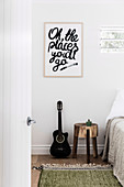Message about guitar and bedside table in the bedroom