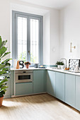 Modern kitchen with pale blue cupboards and clean lines