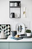 Designer-style kitchen accessories in kitchen decorated in blue, white and grey