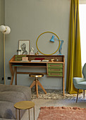Wooden bureau, brass stool and fifties-style standard lamp with spherical lampshades