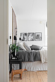 Bedroom in subdued shades with board floor