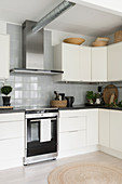 Cream cabinets and rustic accessories in modern kitchen