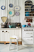Vintage kitchen with plate rack and decorative wall plates on wall