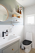 Small, classic bathroom in white and grey with subway tiles