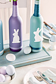 Painted bottles decorated with Easter bunnies