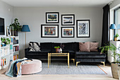 Black velvet couch and brass coffee table in living room