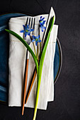 Festive table setting with scilla flowers for Easter holiday dinner