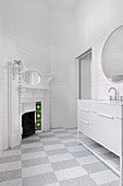 White bathroom with open fireplace and checkerboard floor
