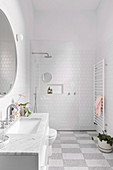 White bathroom with checkerboard floor and walk-in shower