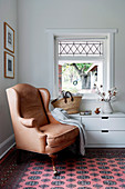 Antique leather armchair in corner of room