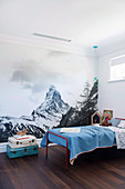 Wall mural with landscape motif in the simple children's room