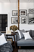 Photo wall with black and white photos in the monochrome living room