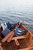 Blue patterned pillows in a rowboat on the lake