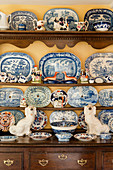 Collection of crockery and china figurines on old dresser