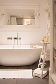 Modern oval bathtub in white, vintage-style bathroom
