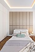 Double bed in bright, elegant bedroom