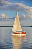 Sailing boat on lake