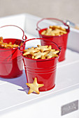 Star-shaped snacks in miniature red buckets