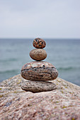 Stacked pebbles on sea shore