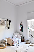 Children's room in light natural tones with a cot and ethnic decoration