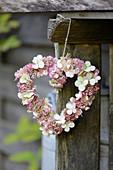 Heart-shaped wreath made of sedum and hydrangea flowers