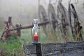 Misty November atmosphere (lit candle in candle lantern)