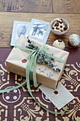 Gift rustically wrapped and decorated with sealing wax and lichen-covered branch