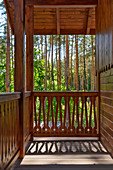 Balcony of country house with view of pine woods