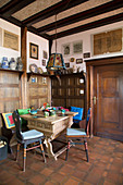 Solid wooden table in wood-panelled parlour
