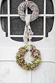 Hydrangea wreath on white wooden door
