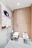 Modern artwork in bathroom with fitted cupboards