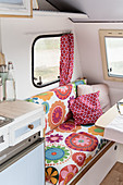 Retro-style floral couch in renovated 80s caravan